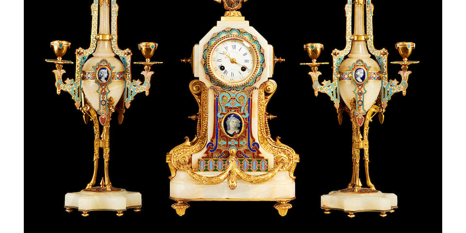 A third quarter 19th century onyx, gilt bronze and champlevé enamel clock garniture by Barbedienne