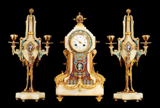 A third quarter 19th century onyx, gilt bronze and champlevé enamel clock garnitureby Barbedienne
