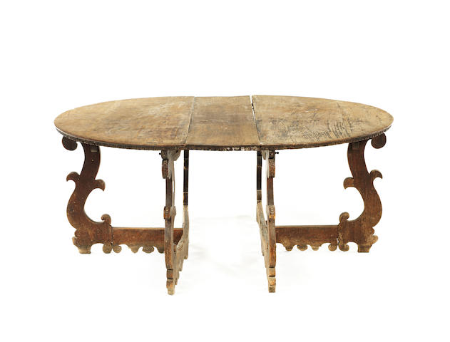 A pair of Italian late 17th /early 18th century and later demi-lune walnut console tables