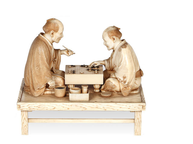 A Japanese ivory okimono figure group