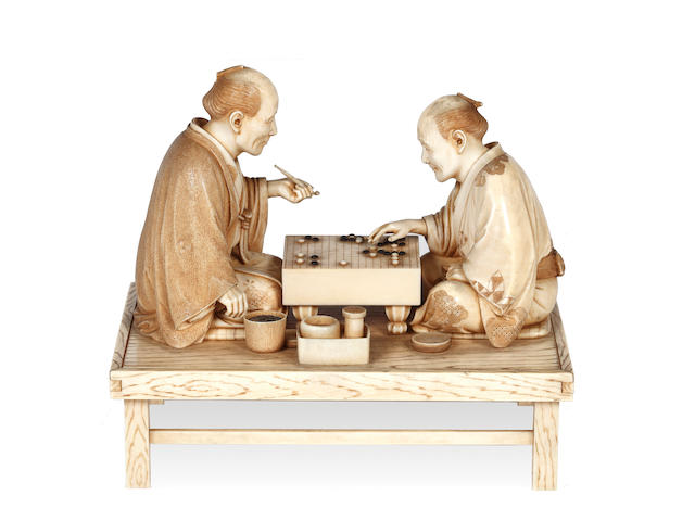 A Japanese ivory okimono figure group, Meiji period