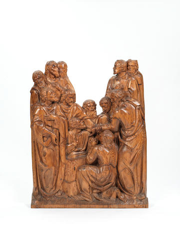 A large South German or North Italian carved pine panel of the Apostles  circa 1800
