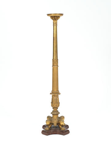 A French late 19th century gilt-bronze floor standing torchèrein the manner of Barbedienne