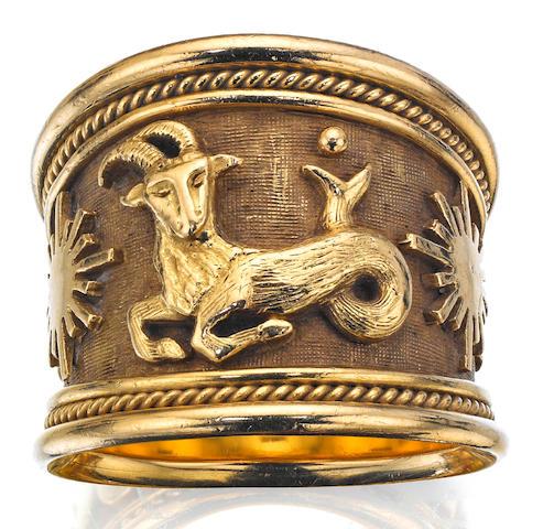 An 18ct gold 'Zodiac' ring, by Elizabeth Gage, London 1990