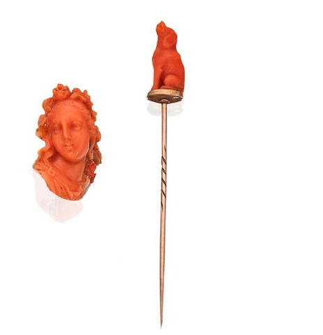 A carved coral stick pin and brooch
