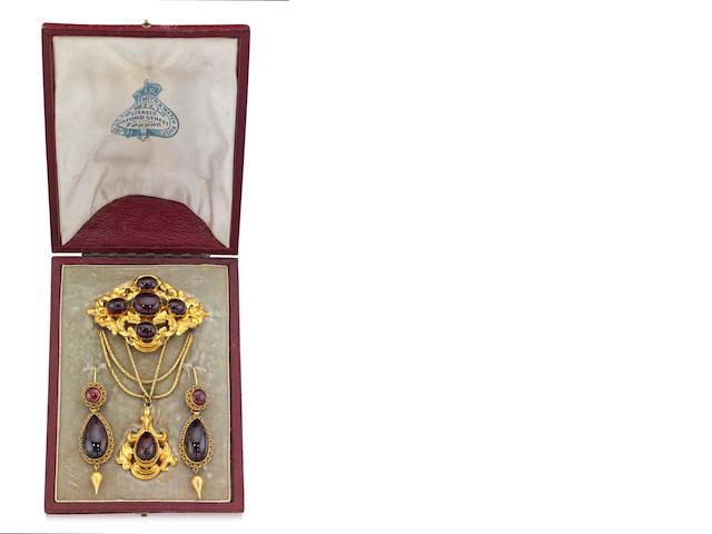 A mid 19th century garnet brooch and pair of pendent earrings