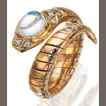 A moonstone and diamond serpent ring