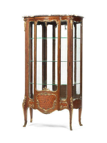 A French late 19th century Louis XV style ormolu-mounted mahogany vitrine