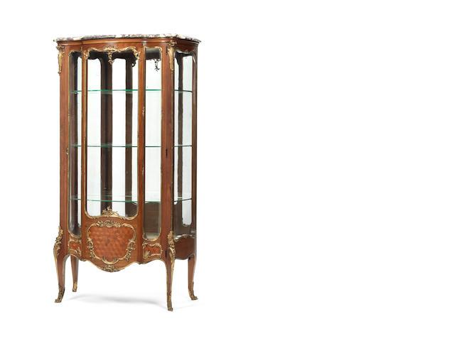A French late 19th century Louis XV style ormolu-mounted mahogany vitrine