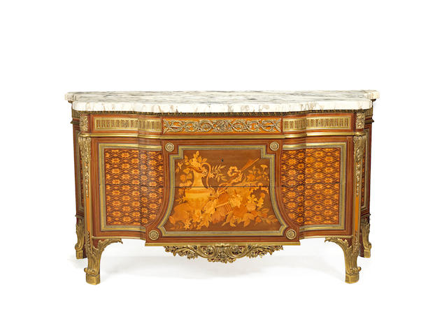 "A French late 19th century ormolu-mounted maple, mahogany, citronnier and fruitwood marquetry breakfront commode after the model of the commode ""de Fontainebleau"" by Riesener"