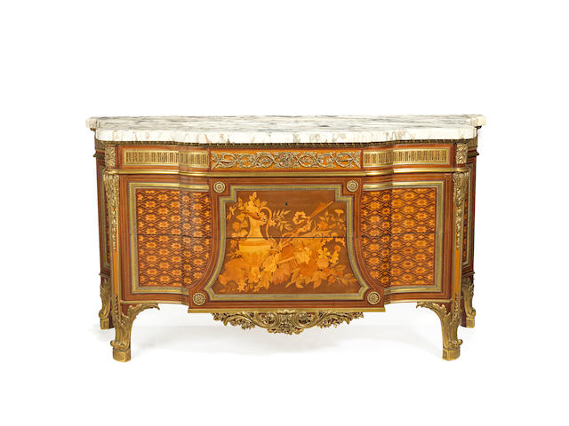 "A French late 19th century ormolu-mounted maple, mahogany, citronnier and fruitwood marquetry breakfront commodeafter the model of the commode ""de Fontainebleau"" by Riesener"