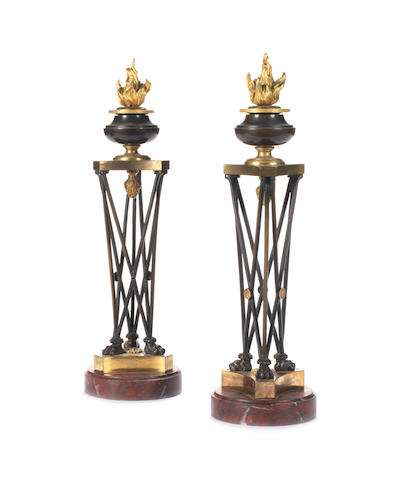 A pair of chiseled, patinated & gilded bronze torchlight, Directoire period