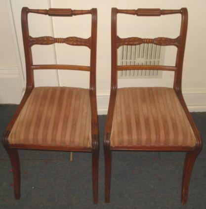 A set of seven Regency style mahogany dining chairs, 19th Century, the moulded frames with turned and palmette carved bar backs, drop-in seats, on sabre legs.