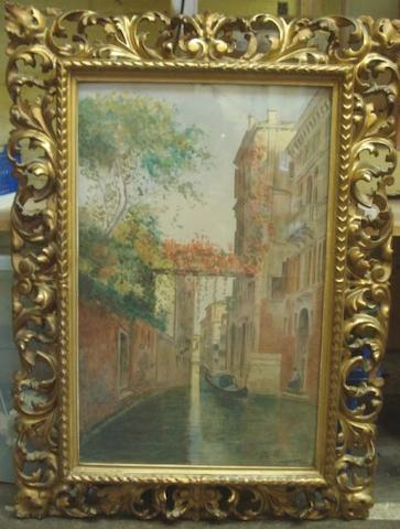 E Masini   A Venetian Backwater, signed, watercolour, 61 x 38cm, in a Florentine leafy scroll carved and pierced giltwood frame.