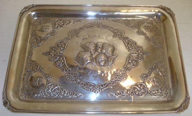 A late Victorian rectangular silver dressing table tray, H Matthews, Birmingham 1898, embossed to the centre with angel masks amongst strapwork and foliate scrollwork, 32 x 23cm, 17ozs.