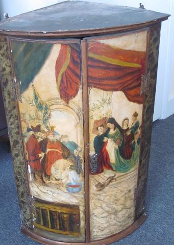 A late 18th Century Continental polychrome painted hanging corner cupboard