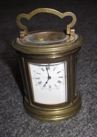 A late 19th Century French brass oval carriage clock
