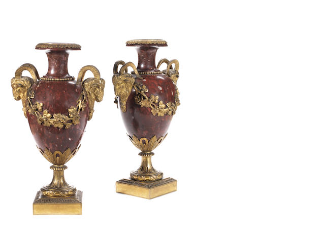 A pair of 19th century Louis XVI style Rouge Griotte marble and gilt bronze mounted urns