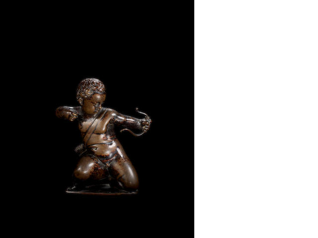 Circle of Barthelemy Prieur, French (1540-1611):  A French late 16th / early 17th century bronze figure of Cupid