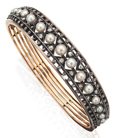 A late 19th century pearl and diamond bangle, French,