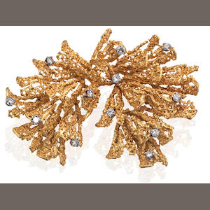 An 18ct gold and diamond brooch,