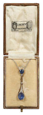 An Edwardian sapphire and diamond pendant necklace in fitted Liberty box