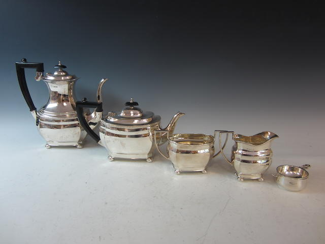 A set of five comprising of a teapot, hotwater pot, cream and sugar, and teastrainer