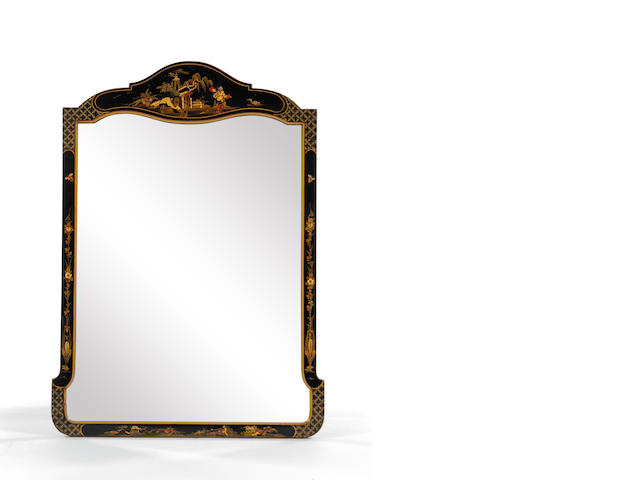 An early 20th century black-painted, parcel-gilt and Chinoiserie-decorated wall mirror, circa 1920, in the early 18th century manner