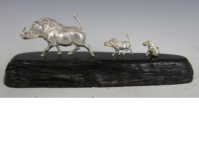 A silver model of a wart hog family by Patrick Mavros, Zimbabwe circa 1995
