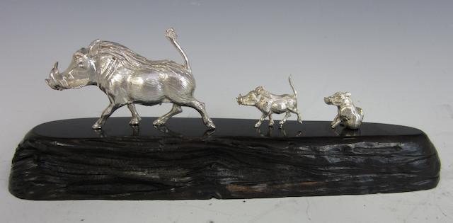 A silver model of a wart hog family by Patrick Mavros, Zimbabwe circa 1995