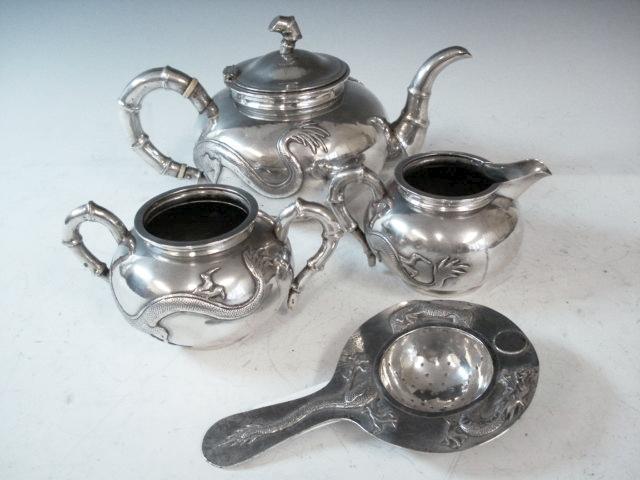 A Chinese silver four piece tea service by Luen Wo, Shanghai circa 1900