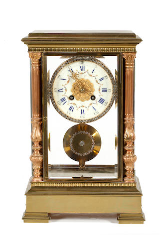 A French brass four-glass mantel clock