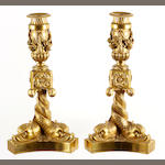 A pair of gilt metal candlesticks