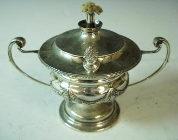 A silver spirit two-handled urn-shape table lighter by Woodward and Co. Ltd., London 1913