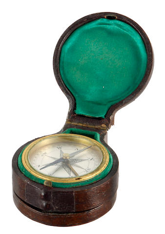 A combined pocket compass and barometer