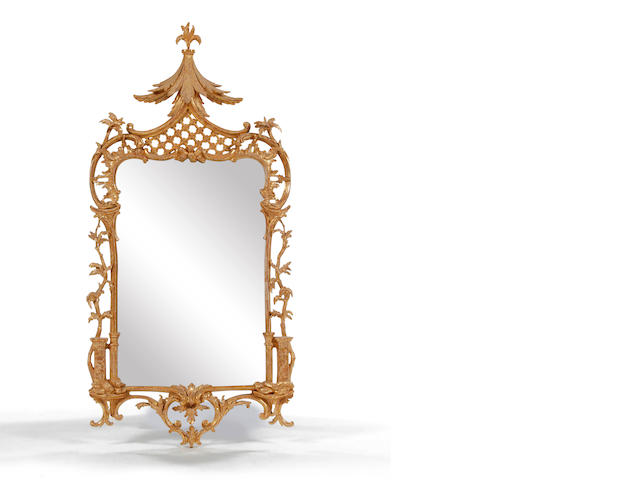 A carved giltwood wall mirror, in mid-18th century style