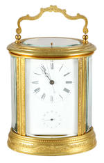 A French late 19th Century brass oval carriage clock