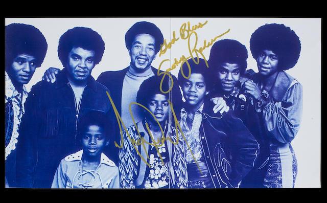 An autographed Michael Jackson/Smokey Robinson photograph,