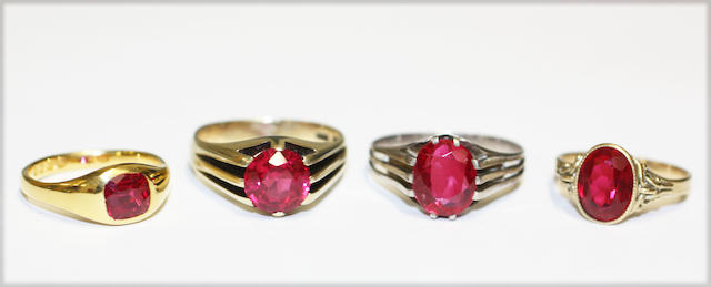 A collection of synthetic ruby set rings, (4)