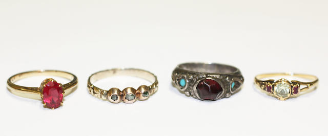 A collection of four gem set dress rings, (4)