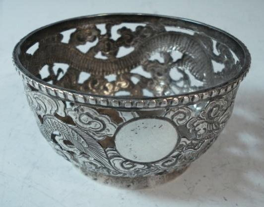 A Chinese silver circular pierced bowl by PS, untraced, circa 1890