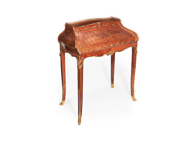 A Napoleon III gilt metal mounted kingwood marquetry and parquetry bureau en pente in the Louis XV style
