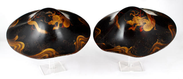 A pair of early 20th Century Japanese black lacquered warriors hats