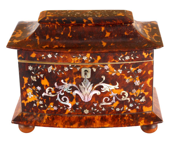 A Victorian tortoiseshell mother-of-pearl inlaid tea caddy