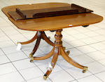 An early 20th Century George III style mahogany twin pedestal dining table