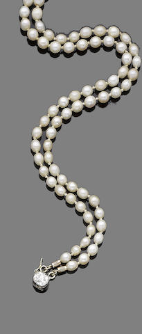 A double strand pearl necklace and diamond clasp