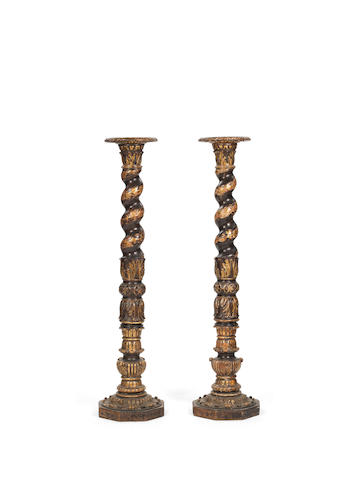 A pair of Italian 18th century parcel-gilt and dark brown painted wood columns