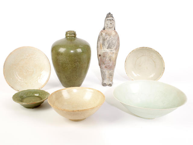 A group of six Chinese glazed vessels and one Chinese figure