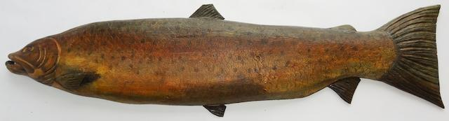 A carved figure of a salmon