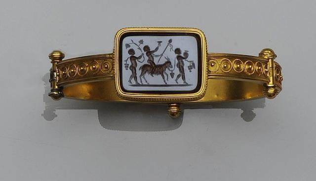An Archaeological Revival agate intaglio bangle and an early 19th century enamel fob watch (2)